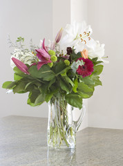 bouquet of summer flowers on kitchen countertop