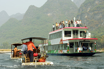 Cruising the Li river near Yangshuo, Guanxi province, China