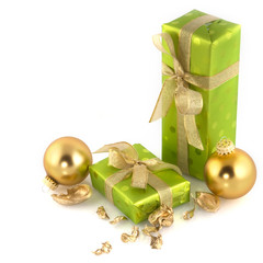 Green shining luxury christmas presents with ornaments