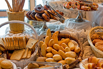 A display of breads and pastries at a buffet
