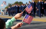 Flag waving at veteran's day parade - Fine Art prints