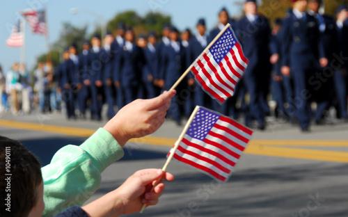 Leinwanddruck Bild Flag waving at veteran's day parade