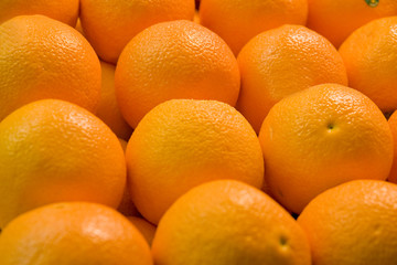 A display of fresh juicy naval oranges in a fruit market