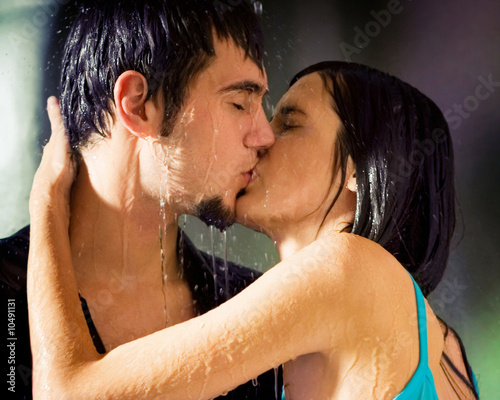 couple kissing in the rain images. Young hugging couple kissing