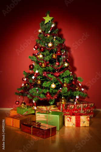 Christmas tree with presents under tree