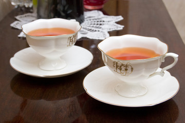 two porcelain cups with tea