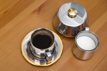espresso and milk in metal set