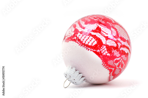 lacy red christmas-tree decoration in the white background