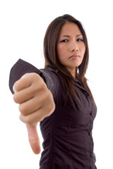female showing thumbs down sign with white background