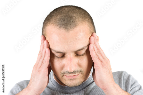 Young man with migraine isolated on white