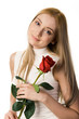 Portrait of beautiful girl holding scarlet rose in hands