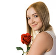 Smiling lady with red rose looking at camera