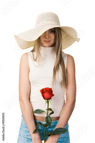 Portrait of elegant lady in hat and rose in hands