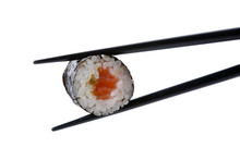 Stock Photo: roll with chopsticks isolated on white