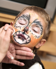 The little boy and a cheerful make-up