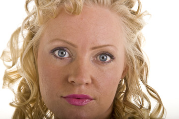 A woman with blonde curly hair and pink lipstick close up