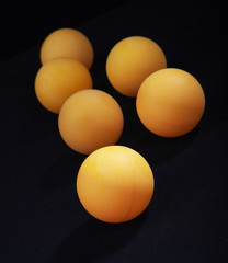 Orange spheres. For ping-pong
