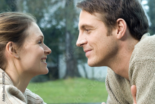 Young couple in love looking into each other's eyes