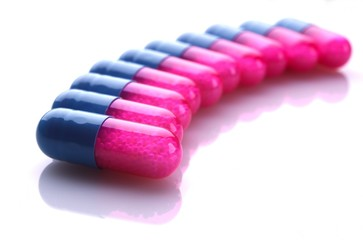 Pink and blue capsules