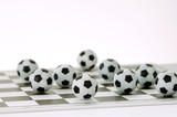 Footballs on a chessboard