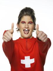 Frau mit schweizer Flagge, gemalt auf Gesicht, Fußballfan