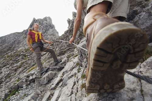 Austria, Salzburger Land, couple mountain climbing
