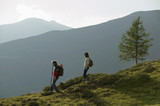 Young couple walking in mountains