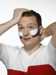 Fußballfan mit tcheschischer Flagge auf Gesicht gemalt, Fußballfan