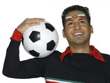 Young man with Iranian flag painted on face holding soccer ball, looking up
