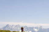 Austria, Salzburger Land, Mature couple hiking, rear view