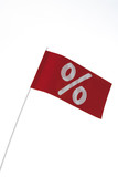 White percent sign on red flag, symbol for bargain