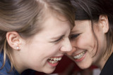 Two young women laughing, close-up