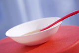 Bowl with plastic spoon and pap