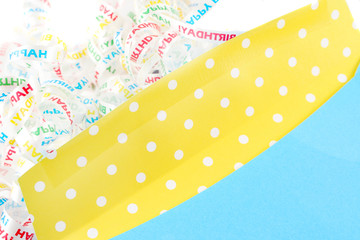 yellow and green empty birthday envelope with polka dots