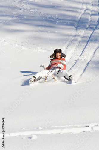 Woman tobogganing in mountains