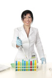 Smiling female laboratory worker stands in front of test tubes poster