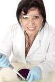 Smiling medical or scientific researcher sitting at desk poster