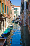 A typical canal in Venice and a bridge