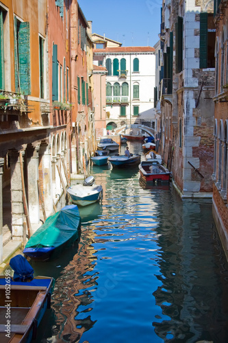 A typical canal in Venice and a bridge - 10526598