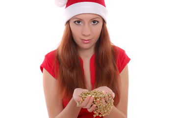 Girl in santa cap with yellow balls