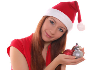 Girl in santa cap with christmas toys