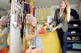 Seller girl gives to a customer bonus-sweets poster