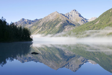 Mountain lake and fog