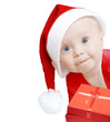 funny baby in Santa hat with present box on white
