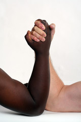 Black and white hand arm wrestling