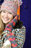 Pretty young girl in winter hat and mittens poster