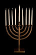 Beautiful unlit hanukkah menorah isolated on black.