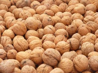 Closeup of English walnuts - background
