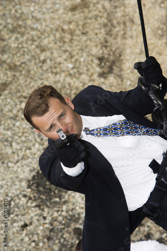 Spy Rappelling and Aiming Gun