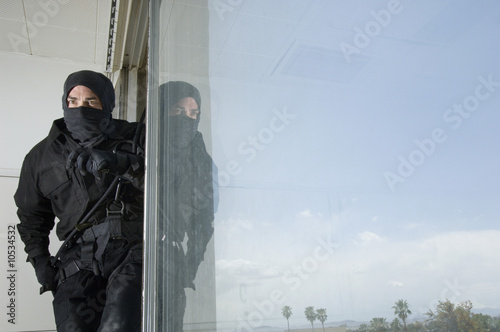 SWAT Team Officer in Window